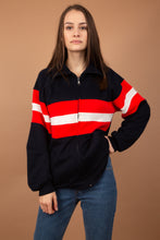 Load image into Gallery viewer, This All-American coloured sweater is navy blue with a large red and white stripe across the middle and is finished off with a closing zip and pockets. This fleece-like sweater is a Winter must-have!