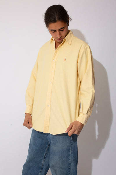 yellow button up with embroidered ralph lauren emblem on left chest