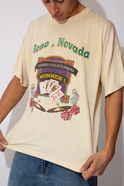 beige single-stitch tee with faded casino graphic and reno nevada spell-out on front
