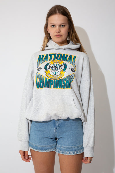 Grey hoodie with green and yellow american football graphic on the front