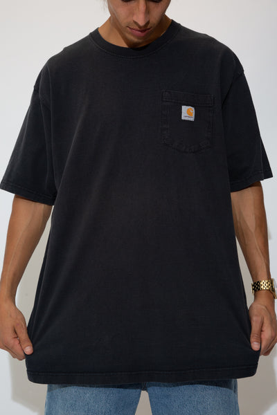 faded black tee with carhartt logo patch on left chest pocket