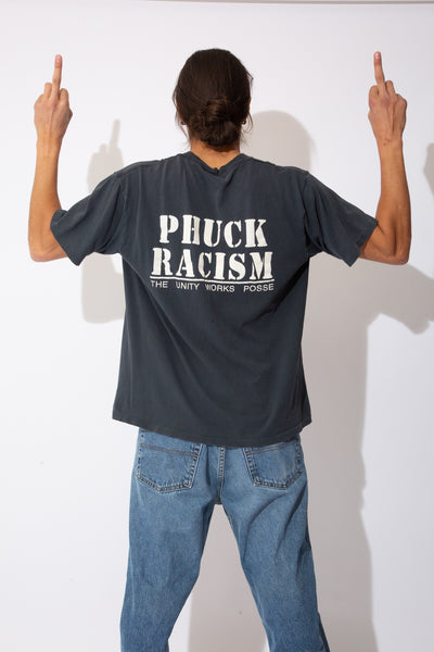 faded black tee with large 'phuck racism' spell-out across back
