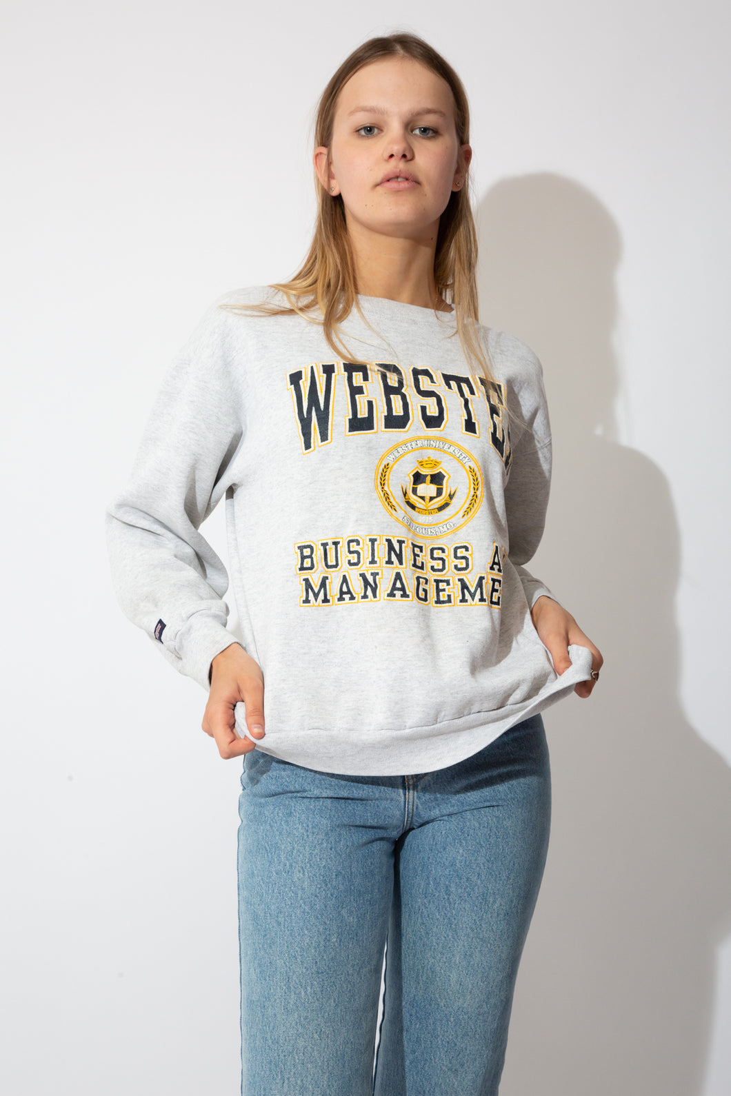 grey marl sweater with navy and yellow webster university graphic on the front