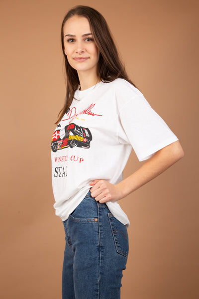 Soft white single-stitch tee with a car graphic and 'Doug Allen' printed across the front. With red and yellow colours and a stretched out neckline, this tee is a 90's fit staple item. Dated 1961-1993.