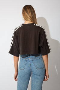 black adidas crop with white stripes on the shoulders and small adidas logo in white on the left chest.