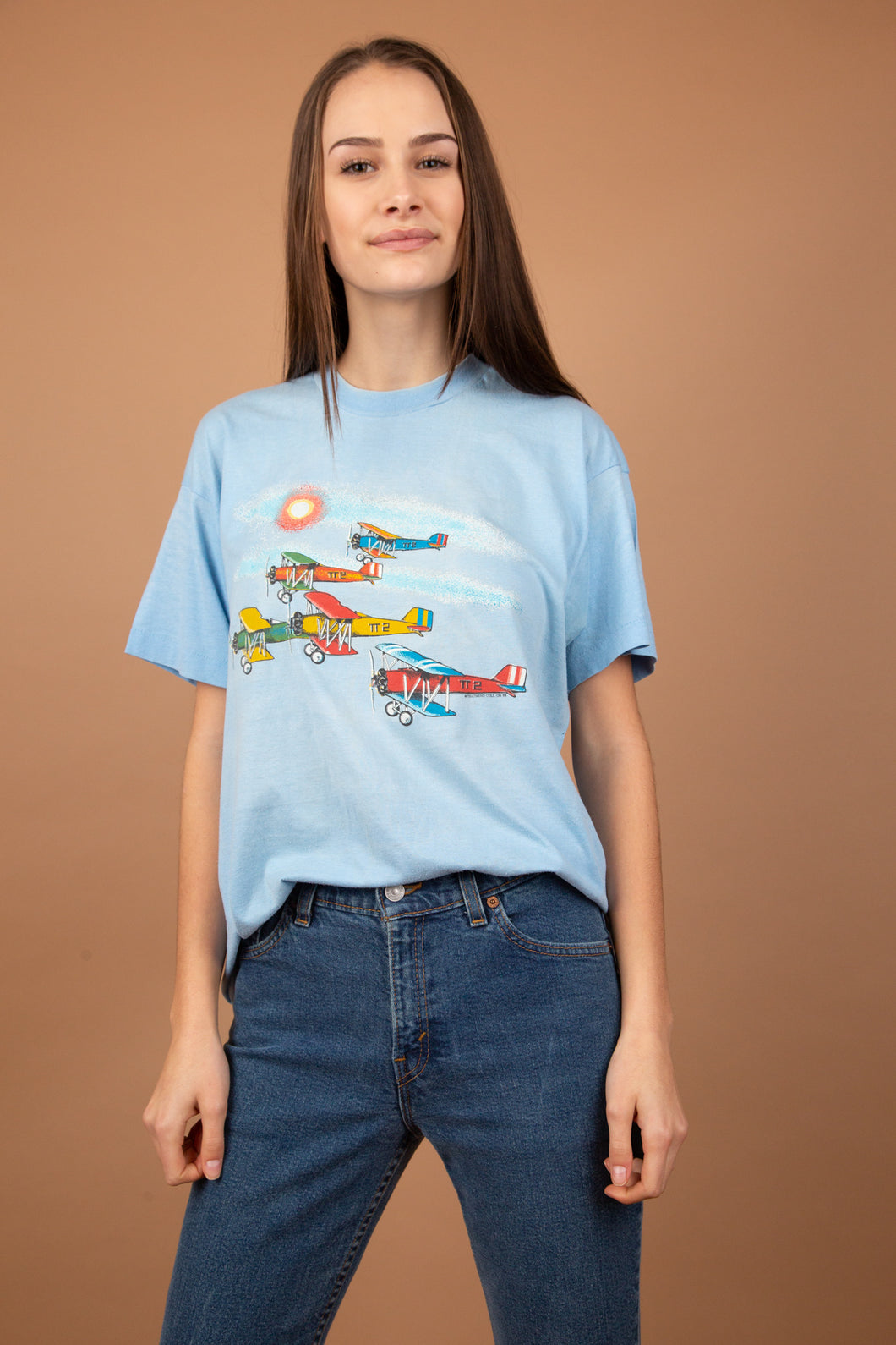 This light blue tee is a soft, loose-fitting top with an aeroplane graphic on the front. Single-stitch and dated '88, this is a vintage must-have.