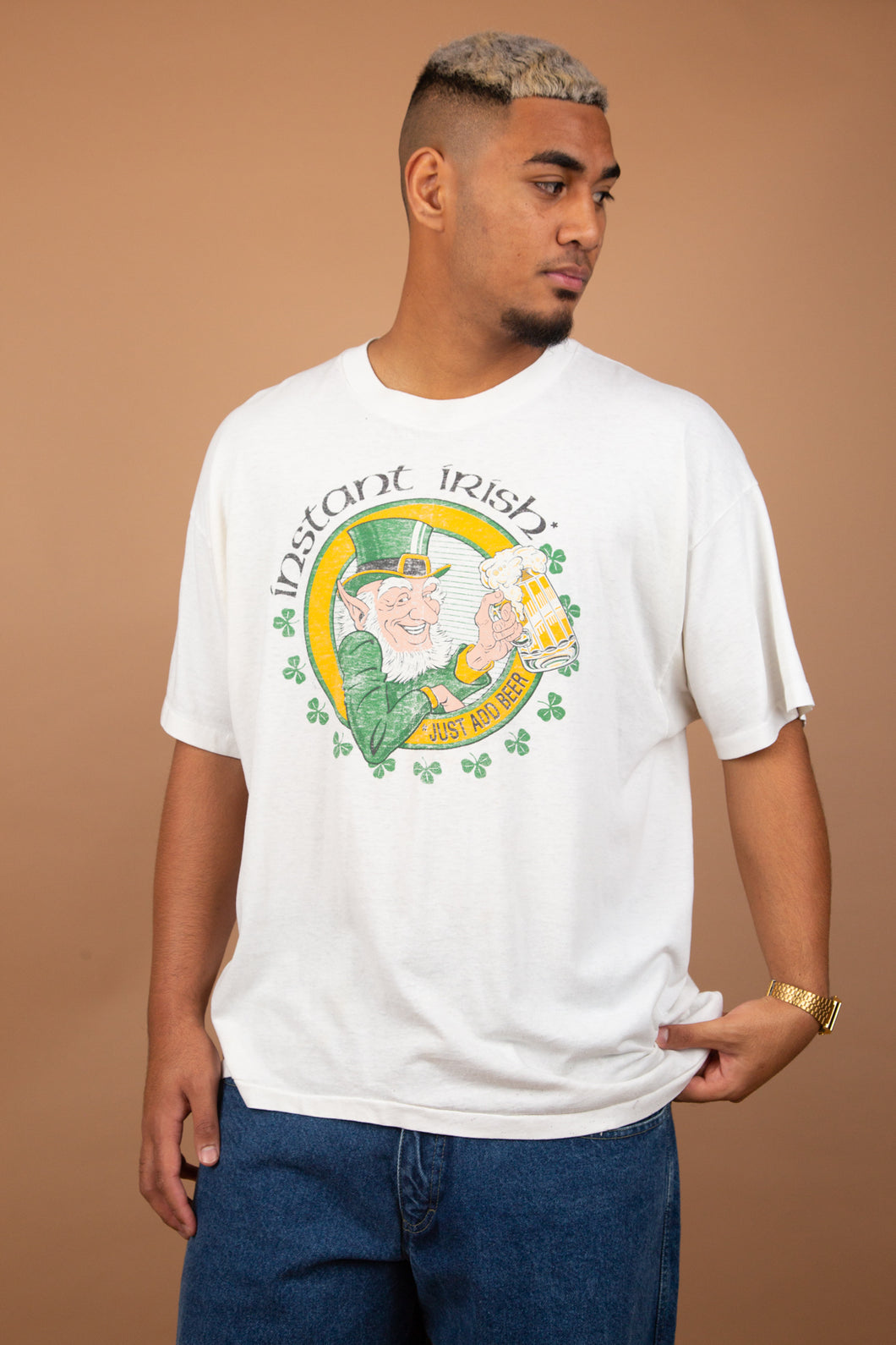 white tee with irish graphic on the front. 90's vintage at magichollow
