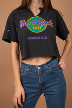 Load image into Gallery viewer, Faded black in colour with the Hard Rock Cafe logo printed in purple, yellow and green on the front. Cropped to keep it cute with a v-cut and distressing on the neckline.