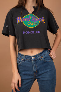 Faded black in colour with the Hard Rock Cafe logo printed in purple, yellow and green on the front. Cropped to keep it cute with a v-cut and distressing on the neckline.