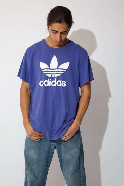 vibrant purple oversize tee with large white adidas trefoil logo and spell-out graphic