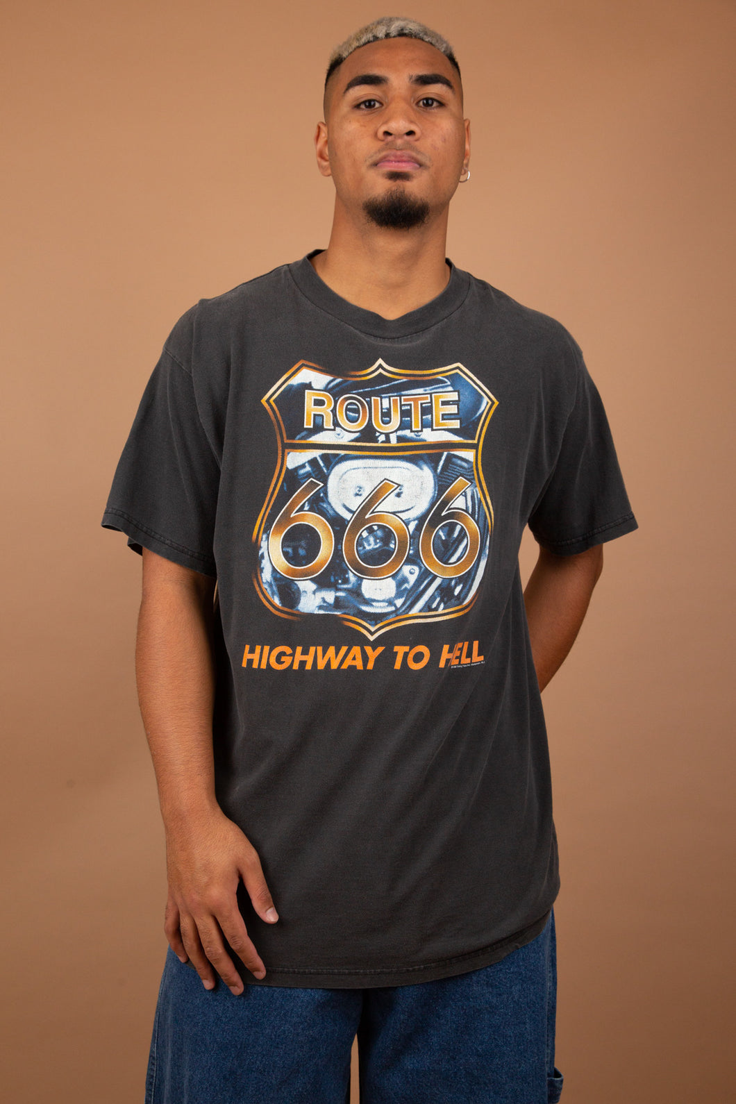 Faded black tee with Route 666, highway to hell graphic on the front. vintage magichollow