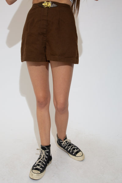 Brown in colour with a soft cotton feel and high-waisted design, these shorts are finished off with a closing zip and a gold and leather fitted buckle on the waistline.