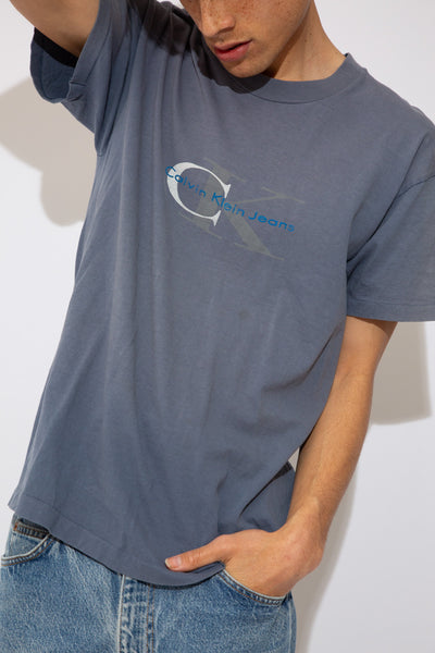 bootleg calvin klein jeans tee with single stitching. faded blue. magichollow