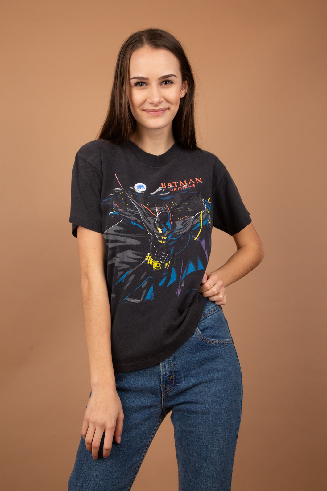 Faded black tee with a colourful vintage Batman print on the front, dated 1991 with 'Batman Returns' on the right chest.