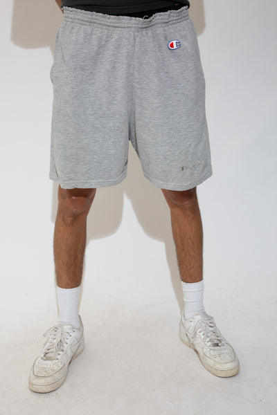 grey sweat-shorts with champion c logo patch on upper left leg and embroidered spell-out on lower left leg