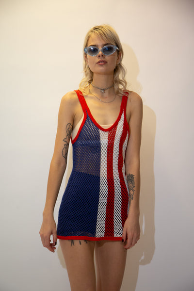 This knitted dress is coloured to mimic the American flag. With its see-through, sexy style and bright colours, this dress would looks sick over a white bikini with some jandals and sunnies.