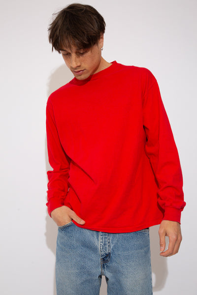 red longsleeve with plain front/sleeves and white text graphic across back - vintage from magichollow!