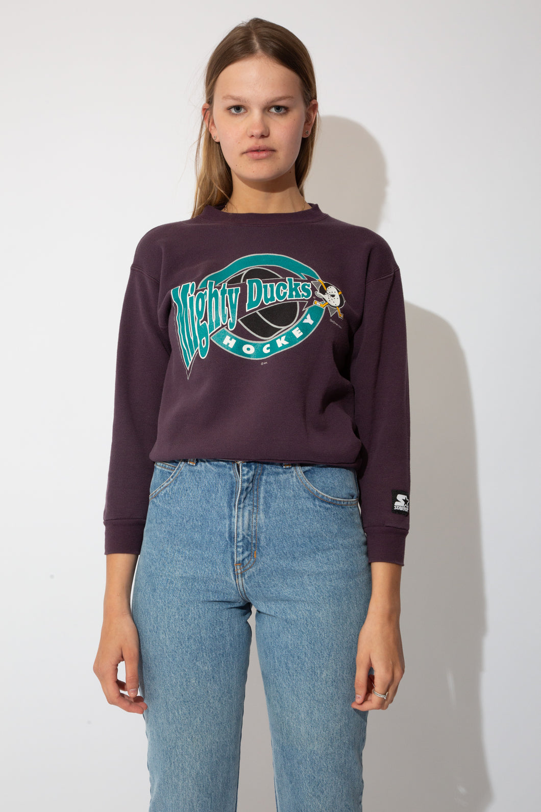 purple starter sweater with