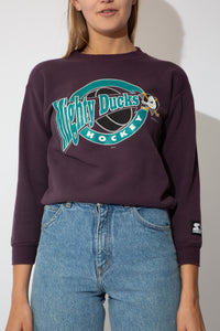 "purple starter sweater with ""mighty ducks"" Anaheim ducks logo on the front"