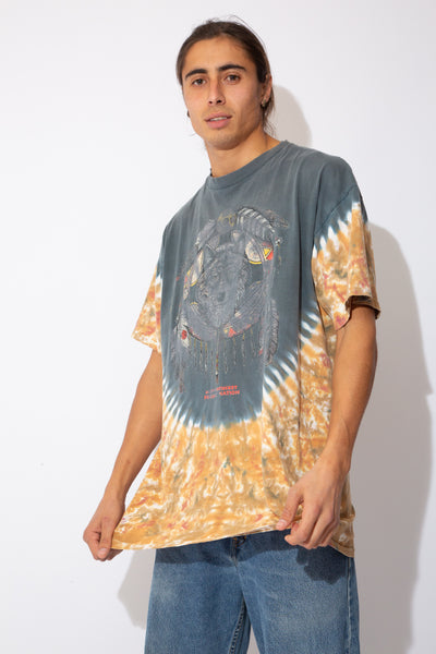multicoloured tee with tie-dye detailing around lower sleeves and front/back, faded wolf graphic on centre chest