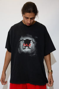 faded black tee with b&w taz graphic and red text on centre chest