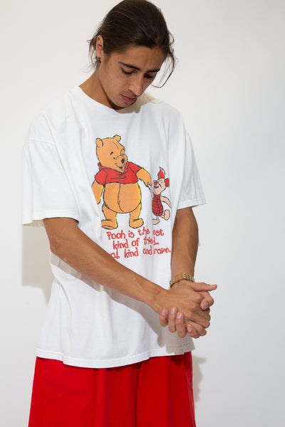 white tee with large pooh and piglet graphic with cute lil text quote about best friends