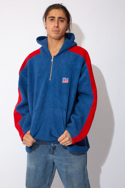 blue fleece hoodie with quarterzip closure, front pocket, embroidered RL flag detailing on left chest, and contrasting red stripes down sleeves