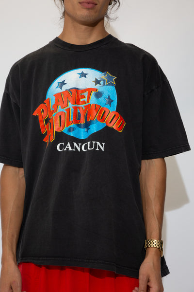 black tee with large planet hollywood logo graphic on front