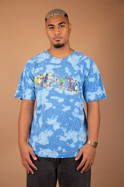 blue cloudy patterned tie-dye tee with looney tunes characters on front