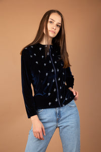 This blue must-have is a velvet-like material with white stitched butterflies on the front. With a tailored fit and 'No Limits' branded on the left chest, this is a fly AF sweater.