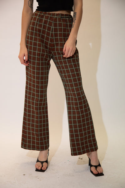 Checkered in dark red, dark green and brown, these pants have an elasticated waist and flared bottoms.