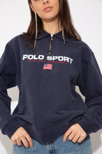 Load image into Gallery viewer, Model wears Navy Blue Ralph Lauren Polo Sport Quarter-zip sweater. vintage clothing at magichollow