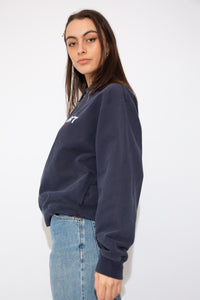 Model wears Navy Blue Ralph Lauren Polo Sport Quarter-zip sweater. vintage clothing at magichollow