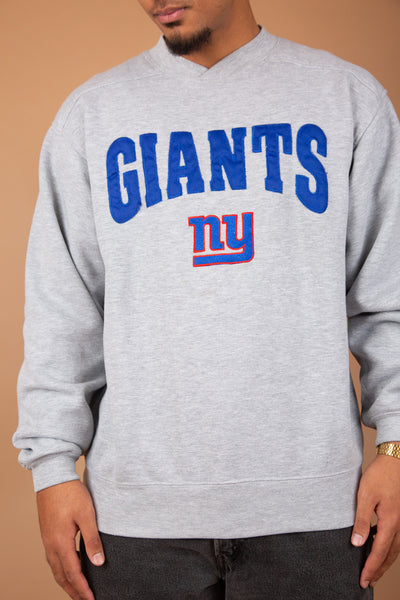 grey v-neck sweater with large blue 'giants' spell-out and ny embroidered logo on chest