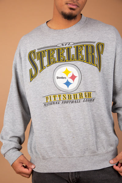baggy grey crewneck with steelers spell-out across chest and logo graphic