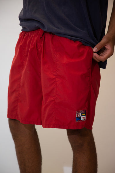 Bright red in colour, these shorts have an adjustable waistband, pockets and a plastic plaque on the left leg repping Chaps Ralph Lauren.