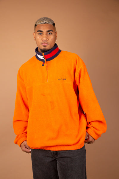 orange fleece quarterzip with tommy branded detailing on collar and embroidered on left chest