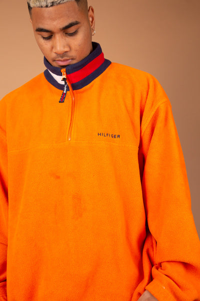 orange fleece quarterzip with tommy branded detailing on collar and embroidered text
