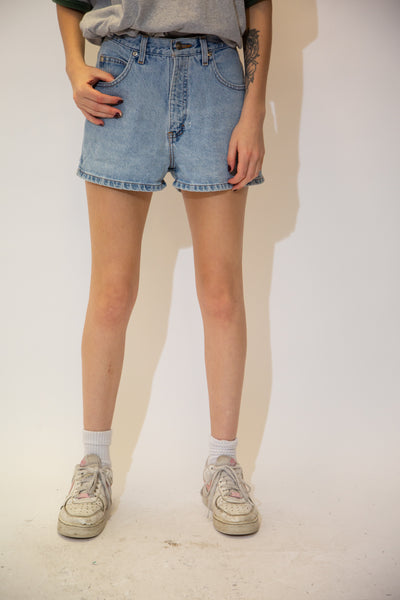 Light wash denim shorts with light brown stitching, pentagon shaped back pockets and branding on the button, domes and back waistline. Pair with an oversized band tee and Jordans for a sick summer fit!
