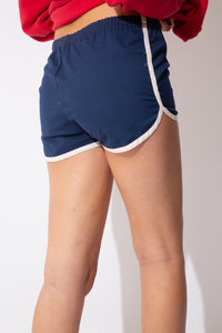 blue short-shorts with white trimming