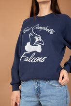 Load image into Gallery viewer, Navy blue in colour with a grey print on the front of a falcon head. 'Fort Campbell Falcons' printed on the front. Has stretched out neckline with ribbed sleeves, neckline and waistline.