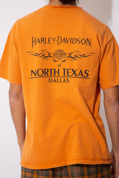 oversize orange tee with harley text graphic on left chest pocket and across back
