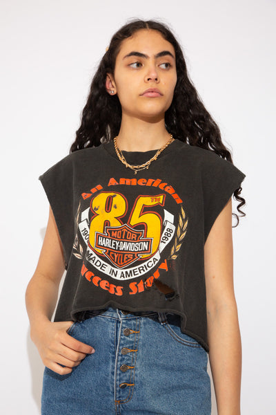 This tee is black with a red, yellow and white print on the front. Celebrating its 85th anniversary in 1988 and repping Nashville, Tennessee on the back. This tee has been cut by the sleeves and waistline to create a distressed, grunge crop.