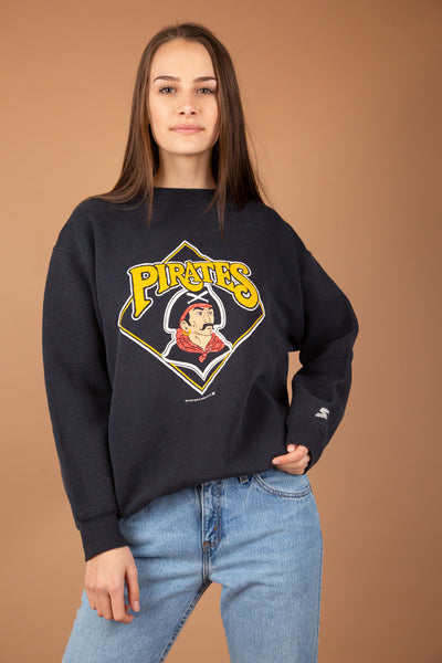 Grab this MLB Starter sweater now! Faded black with a pirate print on the front and 'Pirates' printed in yellow. Dated 1989 with the Starter logo on the sleeve, this is a vintage must-have.