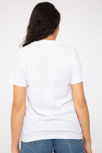 model is wearing a crisp white tee that features a awesome 90s aesthetic print on the front which has the words Book It!