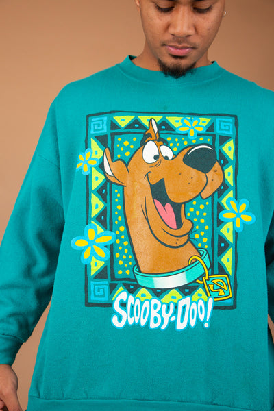 vibrant teal sweater with large scooby doo graphic on front