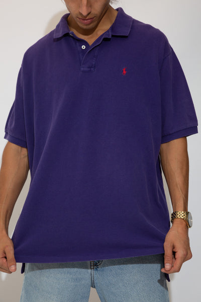 purple polo with red embroidered ralph emblem on left chest