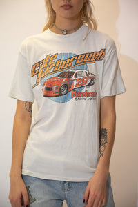 Off white in colour, this single stitch tee has a large orange 'Cale Yarborough' spell-out across the front with a racing car print below. Repping Hardees Racing Team.