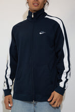 Load image into Gallery viewer, navy zip-up with embroidered nike logo and contrasting white stripes down sleeves