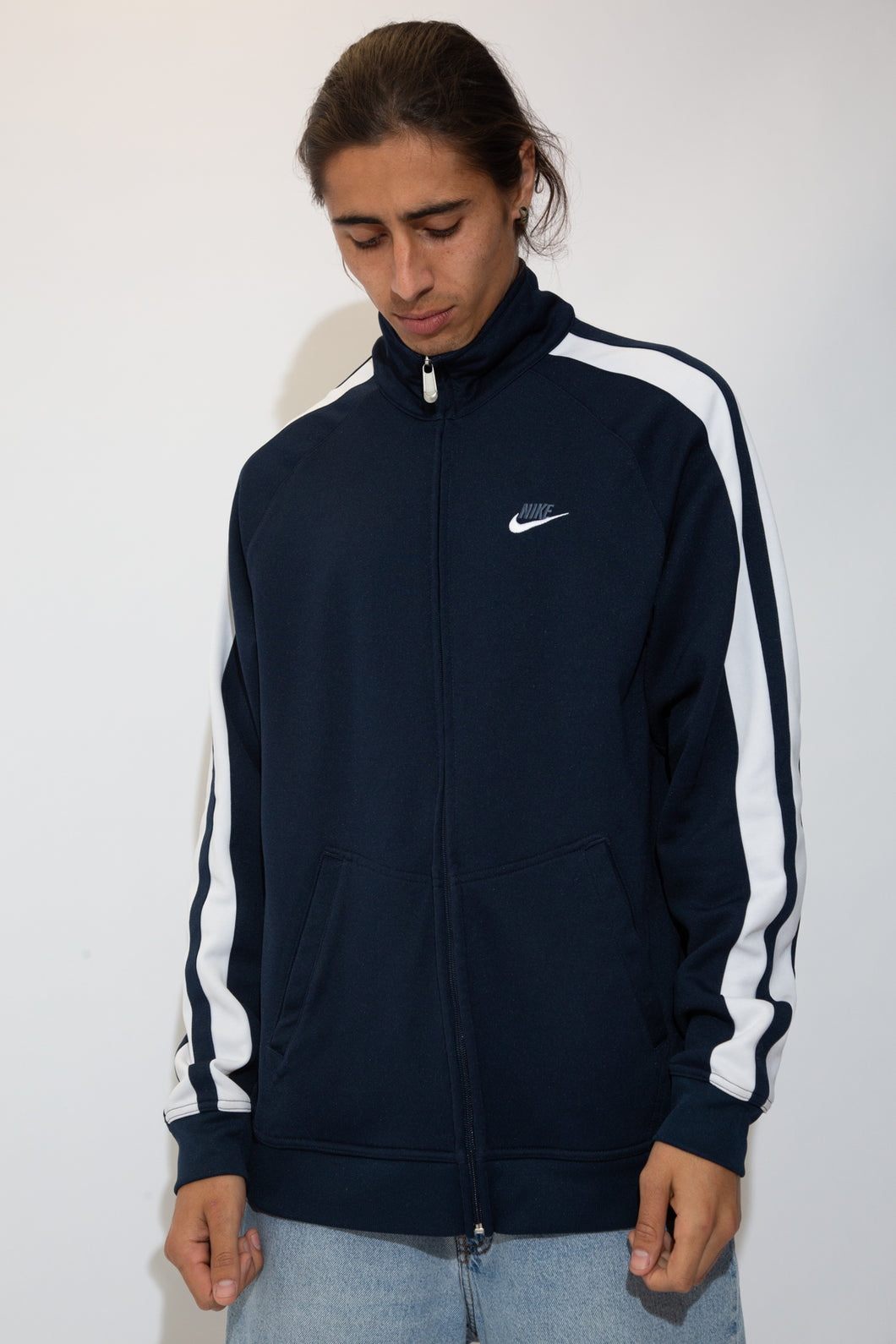 navy zip-up with embroidered nike logo and contrasting white stripes down sleeves